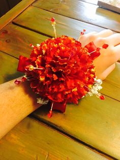 Red prom corsage. Crafty and made with three carnations, elastic, beads, and a heck load of hot glue.