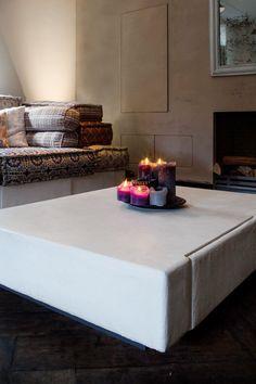 Witte salontafel met betonlook.  www.molitli.nl