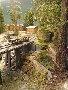 Updated Feb worked on Log Loading area backdrop, adding brush, trees and a little more depth. N Scale Model Trains, Scale Models, Escala Ho, Ho Train Layouts, Tin Can Lanterns, Model Railway Track Plans, Ho Trains, Fantasy Landscape, Handmade Headbands