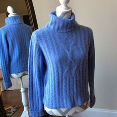 Luxuriously blue cashmere sweater ON SALE The is a beautiful and soft 100% cashmere sweater. The tag is missing but it is identical to the red one I have posted.  In the last picture you can see where a thread has pulled loose but it is not a hole and the turtleneck covers it up.  Sad to sell this luxuriously soft sweater but unfortunately I can't wear cashmere anymore. White + Warren Sweaters Cowl & Turtlenecks