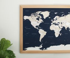"""Track your travels and dream up that next adventure with our handcrafted navy World Push Pin Travel Map. A beautiful and meaningful piece for your modern home, office, or studio. • Our original map design in navy and cream • Handcrafted cedar wood frame with natural finish • 26.5"""" x 38.5"""" (Map is 24"""" x 36"""") • Complete with hooks ready for mounting • Current processing time - 1-2 weeks Gifts for Guys"""