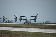Great pic of VTOL...see the wheels just barely coming up off the ground? I love this shot!  V-22 Ospreys Taken at the Marine Week Cleveland