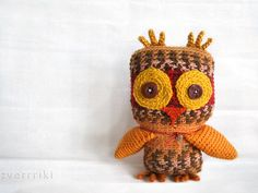 Red Orange speckled owl with eyes like a pumpkin on white back