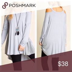 NWT Gray Cold Shoulder Tunic NWT.  Light gray super soft lightweight cold shoulder tunic. Ruching detail on sleeves and contrast side panels.  Tag says medium but would easily fit a large.  Measurements and more pics to come. Tops Tunics