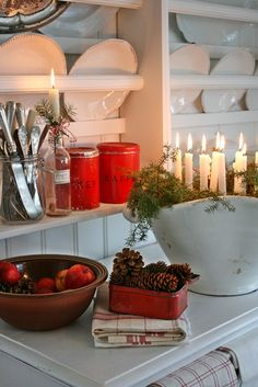 38 Scandinavian Christmas Decorating Ideas -- this is beautiful, but the lighted tapers in amongst the greenery doesn't look very safe to me. I think I would find a different way of getting the effect.