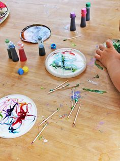 cosmic suncatchers  -- painting on wet glue, looks really super cool & when it dries they make sun catchers -- they use plastic container lids, i would think if you could find the clearish ones that would be best