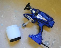 Buh-Bye Blue Trim | Young House Love painting doors and trim with sprayer
