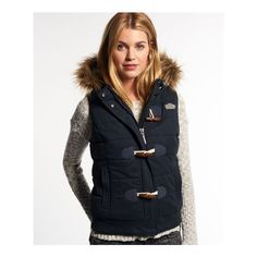 Superdry Microfibre Toggle Puffer Gilet ($95) ❤ liked on Polyvore featuring outerwear, vests, navy, embroidered vest, navy blue vest, navy blue puffer vest, puff vest and navy vest