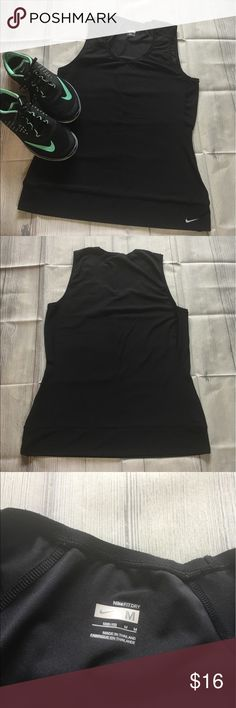 """Nike Black V Neck Dri Fit Top Black dry fit top has a wide waist band and mesh side panels. Measures 16.5""""inches armpit to armpit and 25""""inches long. 88% polyester 12% Spandex. Nike Tops Tees - Short Sleeve"""