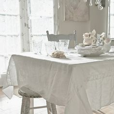 Rachel Ashwell Shabby Chic Couture white lace inlet tablecloth with chippy vintage seating. www.shabbychic.com
