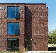 wingender hovenier architectens brick residential building for disabled youth in the netherlands provides a careful balance between communal and private bespoke brickwork garage office