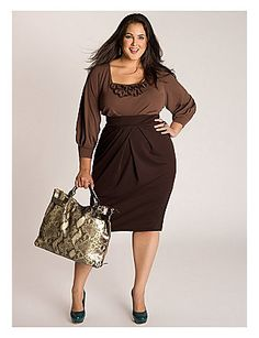 A feminine ruffled collar tops this work-appropriate scoop neckline adding flare and elongating your neck. Figure flattering origami pleats on the bust and at the waist add detail and ease of wear. At heels or boots for fall and your favorite buttery leather tote. sonsi.com
