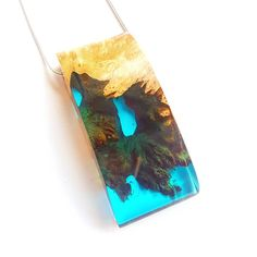 Teal coloured pendant with incredible underwater landscape.  Mixing wood and…