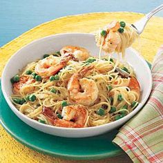 Angel Hair with Shrimp and Peas | MyRecipes.com--could substitute heavy cream and reduce oil to make it healthier