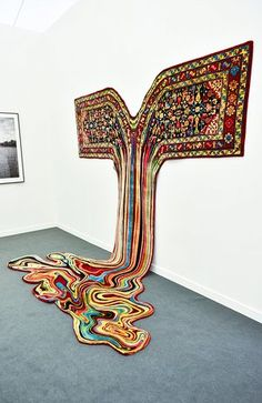 The rugs do work: a carpet work which seems to melt onto the floor.