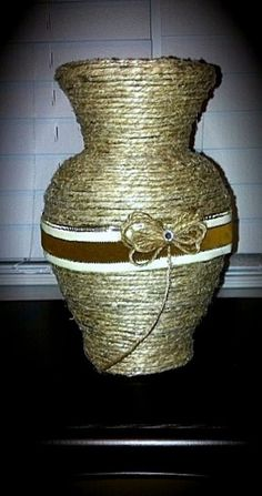 Glass vase wrapped with twine. Added ribbon and twine flower.