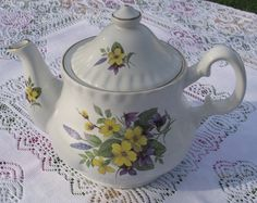 For Rent:  Crown bone china primrose violets pattern in yellow and purples.