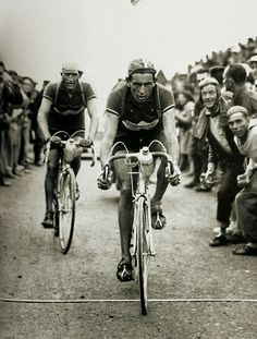 ethicallyimmoral: Fausto Coppi leading Gino Bartali during the 1949 Tour de France (or maybe the 1949 Giro d'Italia) Imagine cycling up a mountain on terrible roads with a bike that weighs about 30 goddamn pounds
