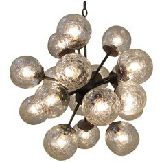 Vintage Glass Cluster Chandelier | From a unique collection of antique and modern chandeliers and pendants  at http://www.1stdibs.com/furniture/lighting/chandeliers-pendant-lights/