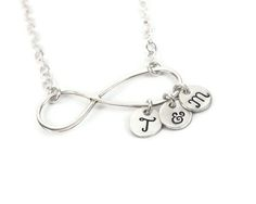 WANT WANT WANT! Infinity Initial Necklace in silver with all of our initials