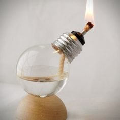 Recycle those old mini light bulbs, transforming them into incredible oil lamps.
