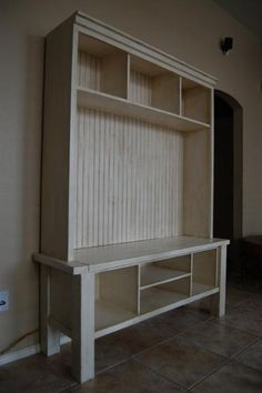 I'm going to make this for the entry way... Shorten the legs on the bottom so it sits flush on the floor (no dust bunny colonies here please), add a cushion on the ledge, and maybe install some hooks from the underside of the top shelf.