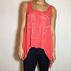 FREE PEOPLE Asymmetrical Tank Beautiful Free People Asymmetrical Tank. -Detailed design in chest area. -High-Low hem. -Color: Coral -Like new!  NO Trades. Please make all offers through offer button. Free People Tops Tank Tops
