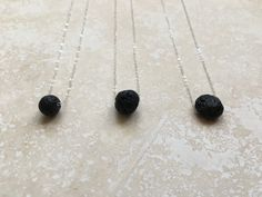 Essential Oil Lava Diffuser Necklace Floating by CuraDesigns