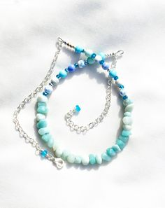 Now selling: Sky Blue Necklace with Amazonite and Porcelain Beads, Gemstone Chips Necklace, Pale Blue Beach Necklace https://www.etsy.com/listing/462767144/sky-blue-necklace-with-amazonite-and?utm_campaign=crowdfire&utm_content=crowdfire&utm_medium=social&utm_source=pinterest