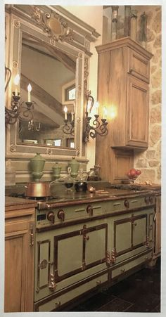 Homeowners hung a 19th century French mirror over their sage colored La Cornue range. La Cornue, French Mirror, Custom Kitchens, Double Vanity, Sage, Kitchen Ideas, 19th Century, House Design, Cabinet