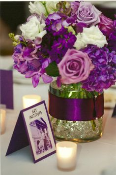 Low centerpiece of dark purple hydrangea, lavender roses, stock and lisianthus