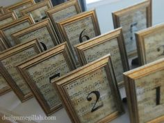 Great use of dollar tree gold frames and copied music pages on to parchment paper and aged with tea bags. Results = unusual way to display numbers for wedding reception tables