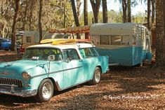 Turquoise car and camper