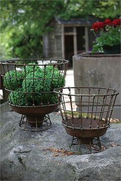 """Whether you want to add vintage style to your cottage garden decor or keep your country farmhouse clutter free, you will love the many uses for these Round Metal Wire Baskets. The aged finish gives them an antique rustic look. Set of two. 12.25"""" Round x 11.5""""H and 10"""" Round x 9""""H"""