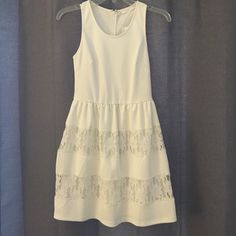 "White Mini Dress with Lace Layers Size XS Brand New! White tank style top that is form fitting. Skirt flares out some with lace layers. Mini dress. Model is 5'5"". ( not Lulu's, boutique brand) Lulu's Dresses Mini"
