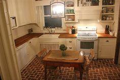 Bead board back splash, older cupboards, brackets, and wood counters.
