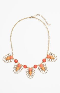 Adore the ombré peach stones on this statement necklace.
