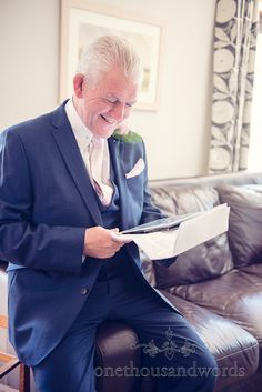 Father of the bride in blue wedding suit practices his wedding speech. Photography by one thousand words wedding photographers