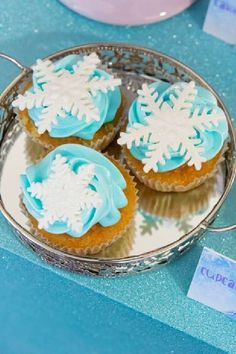 Take a look at this beautiful Frozen birthday party! The cupcakes are so sweet! See more party ideas and share yours at CatchMyparty.com #catchmyparty #partyideas #frozen #frozenparty #princess #princessparty #girlbirthdayparty #cupcakes