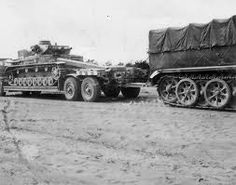 A heavy SdKfz 9 Famo towing it's heavy service trailer with a Panzer 4 payload.