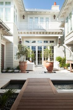 Courtyard with Walkway Over Water Fountain - Cottage - Home Exterior