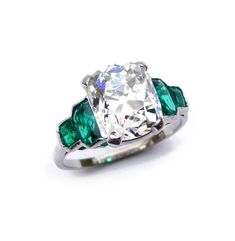 S. J. Phillips, Ltd. - Art Deco single stone cushion diamond and emerald ring, c.1930, the claw set diamond approximately 4.40cts