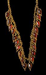 A Delightful Greek Gold and Garnet Strap Necklace. Hellenistic Greece, c. 3rd-2nd century BC