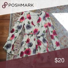 Forever 21 floral romper This never-worn before cream colored romper with gray and magenta flowers features an adjustable drawstring waist and long bell shaped sleeves Forever 21 Pants Jumpsuits & Rompers