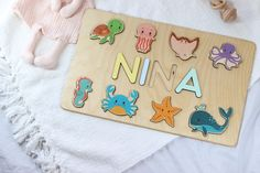 Zoo Baby Shower Gift - Wooden name puzzle by WoodilyToys. Jungle Animals - Personalized new baby gift Newborn - New to the Zoo Onesies. First Christmas gift for baby. Our Personalized custom name puzzles are designed to fuel imagination, inspire exploration and encourage the natural curiosity that leads to a lifetime of learning. #babyroom #nurserydecor