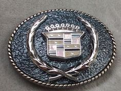 Cadillac Buckle with leather.