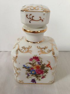 Floral and gold porcelain perfume bottle by Irice. 3.5 tall and 2 wide and 1.5 deep. No nicks or cracks. Made in the late 40s early 50s. A great addition to your vintage or shabby chic vanity or bathroom.