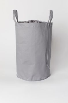Laundry bag in cotton twill with two handles at the top, a woven top section with a drawstring closure and a plastic coating on the inside. Plastic Coating, H&m Home, H&m Gifts, Sissi, Cotton Bag, Holiday Outfits, Fashion Company, Christmas Shopping, Black House