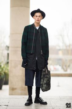 Korean male model showing us his cool layered up outfit. He pulls off the mix of formal and casual perfectly.