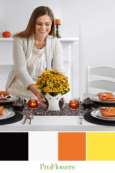 What do you get when you contrast burnt orange fall flowers with a black and white owl vase? A visual feast!